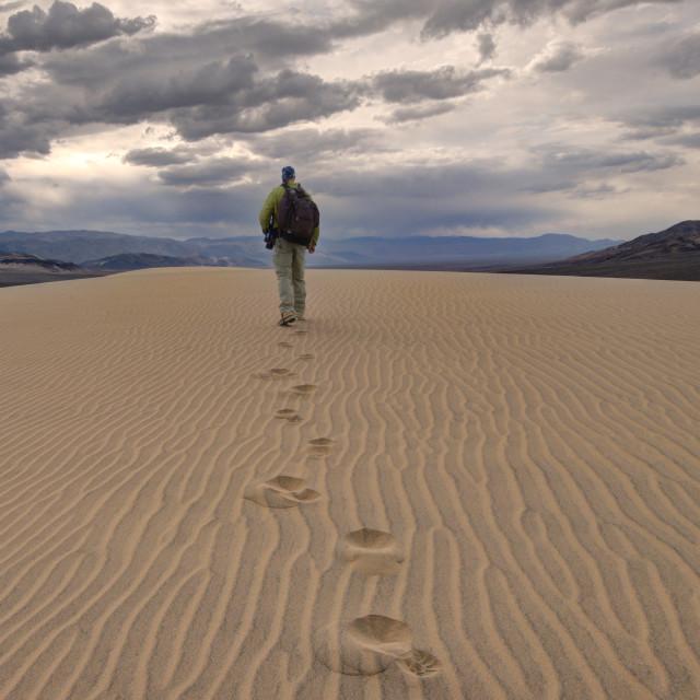 """Hiker in the Eureka Dunes"" stock image"