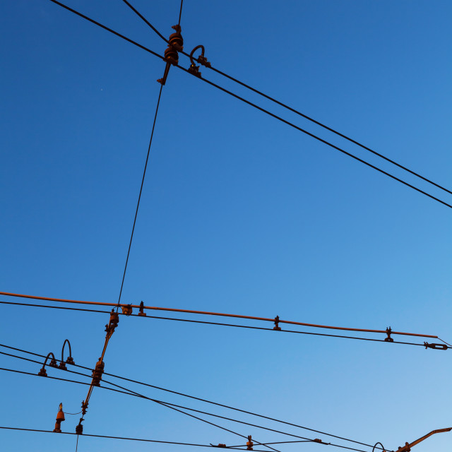 """""""Electric traction lines against the blue sky"""" stock image"""
