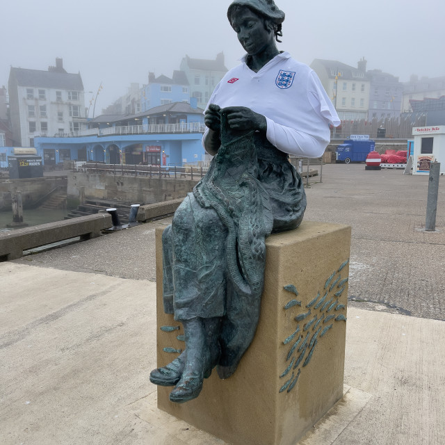 """Gansey Girl Bronze Statue with England Football Team Shirt."" stock image"