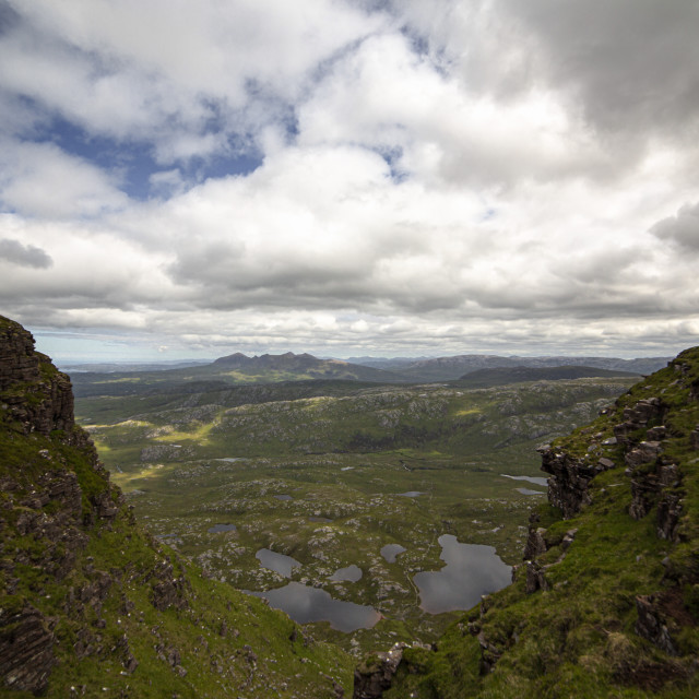 """""""Between Two Peaks. Reaching the Summit of Suilven."""" stock image"""