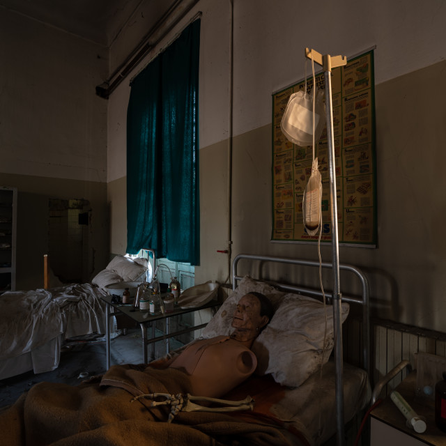 """""""A mannequin lying in the bed of a disused psychiatric clinic"""" stock image"""