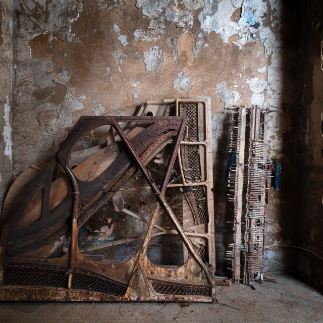 """""""Damaged Piano Against the Wall"""" stock image"""