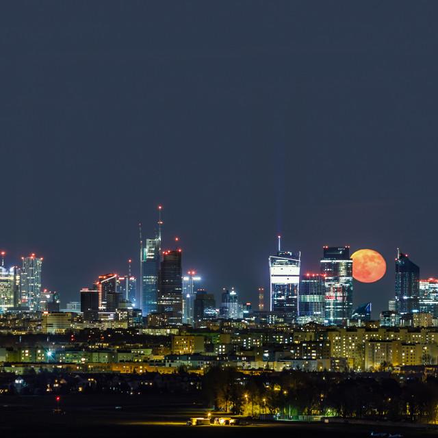 """Moonrise over Warsaw, capital of Poland"" stock image"