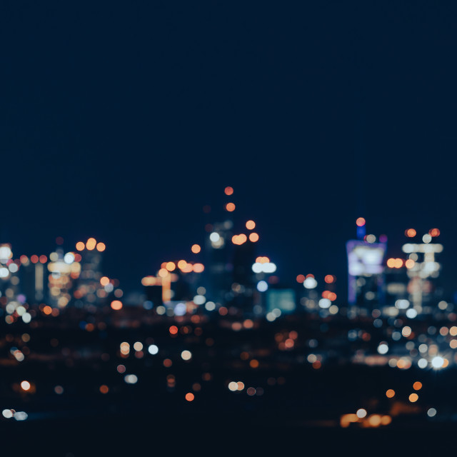 """""""Warsaw skyscrapers by night, abstract defocused image of night city"""" stock image"""