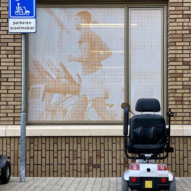 """""""Physio & parking mobility scooter on the sidewalk outside a medical health clinic."""" stock image"""