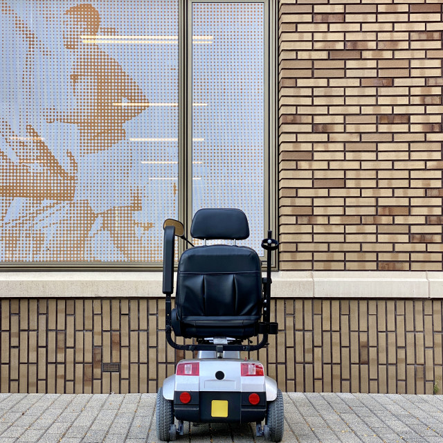 """""""Physio entrance & parking mobility scooter outside a medical health clinic."""" stock image"""