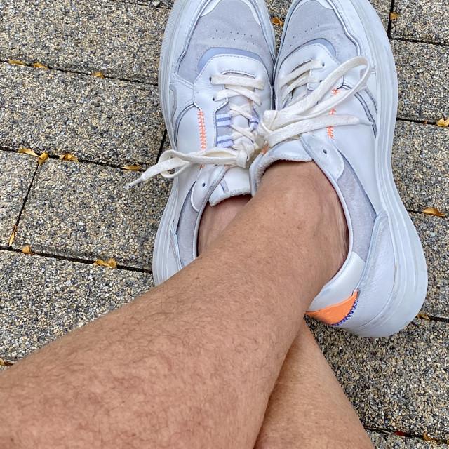 """Close-up selfie of man's legs."" stock image"