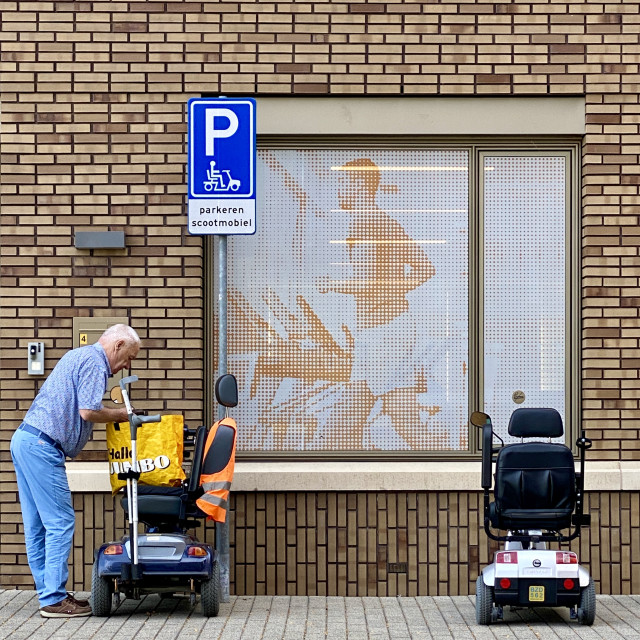 """""""An elderly man at the entrance."""" stock image"""