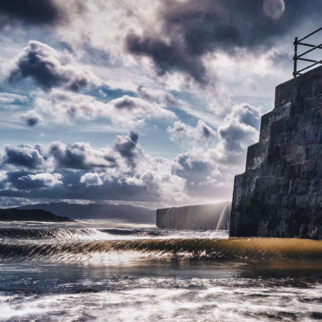"""Criccieth Beach sea defence, Wales, UK."" stock image"