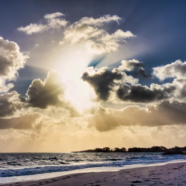 """Ocean Sunburst Clouds"" stock image"