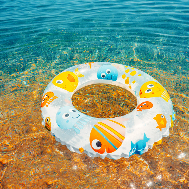 """""""Children buoy in sea water. Swimming ring on the beach."""" stock image"""