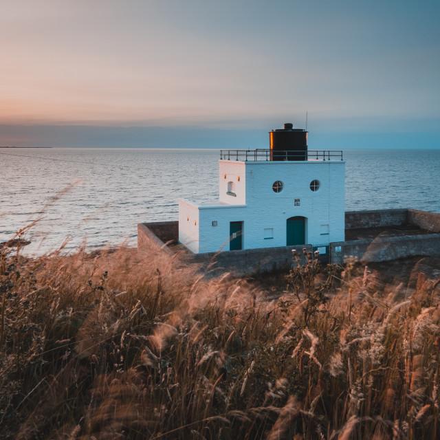 """""""Orange and Teal Bamburgh Lighthouse, Northumberland"""" stock image"""