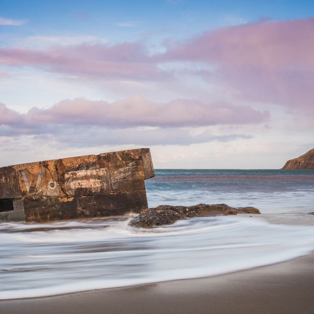 """""""Soft sunset light over the pillbox at Cayton Bay, North Yorkshire"""" stock image"""