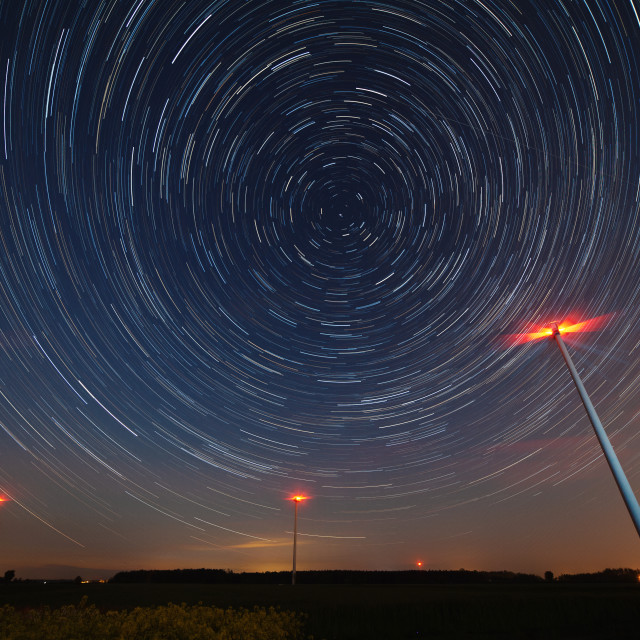 """""""Windmill against startrail. Starry night moody picture."""" stock image"""