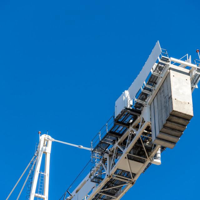 """Close-up of construction crane against blue sky"" stock image"