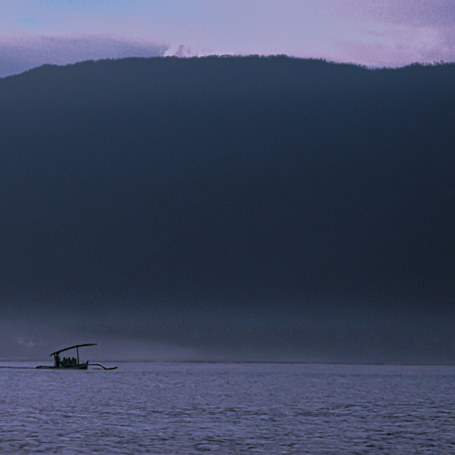 """Sea, mountains, jukung boat, dusk"" stock image"