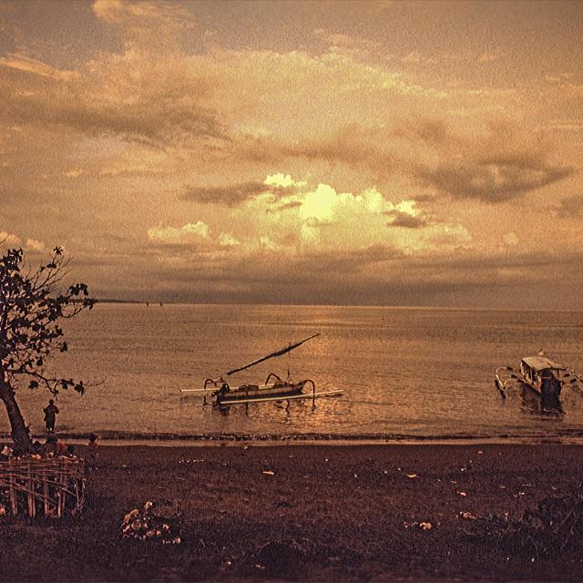 """Balinese in jukung boat"" stock image"
