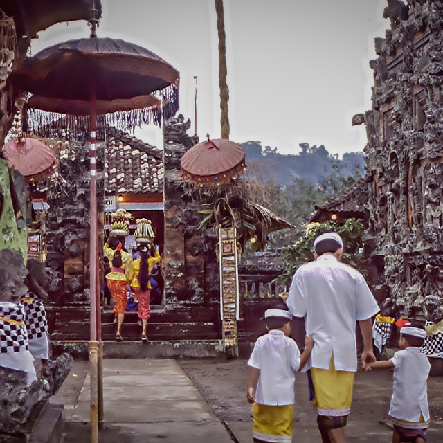 """Man & boys enter Pura Manik Tirta temple."" stock image"