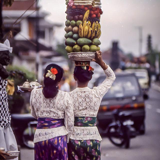 """Balinese women bring offerings to Pura Manik Tirta temple"" stock image"