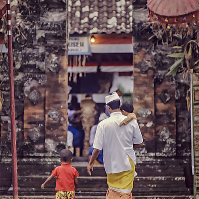 """Man & boys enter temple"" stock image"