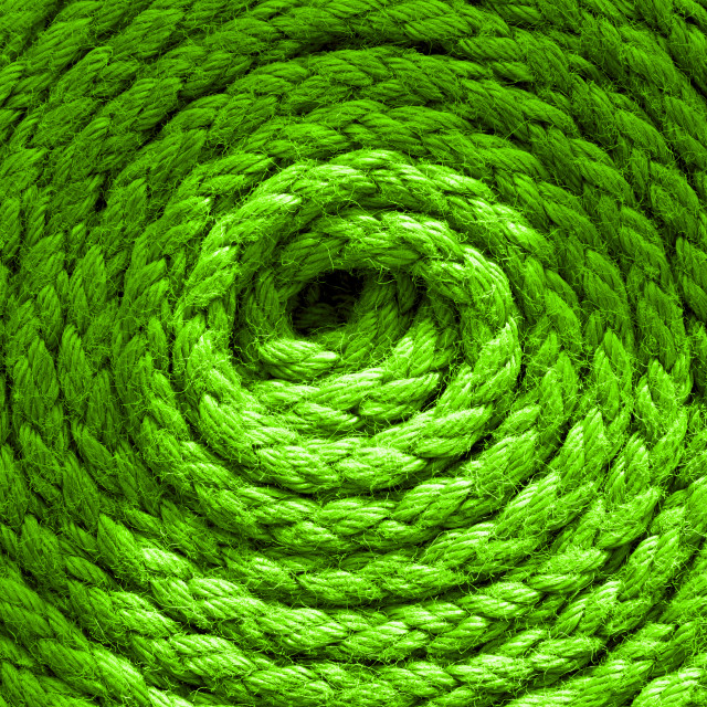 """""""Heavy-duty bright green coiled ships rope looking from above. Round shapes for concept & copy space."""" stock image"""