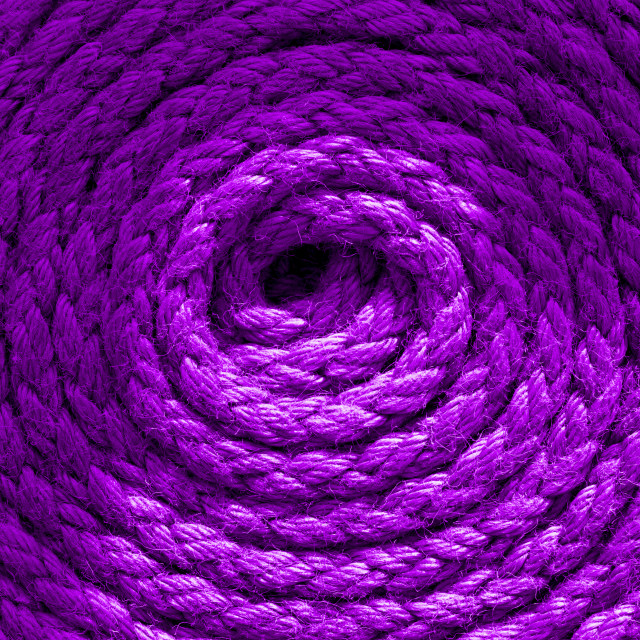 """""""Heavy-duty bright purple coiled ships rope looking from above. Round shapes for concept & copy space"""" stock image"""