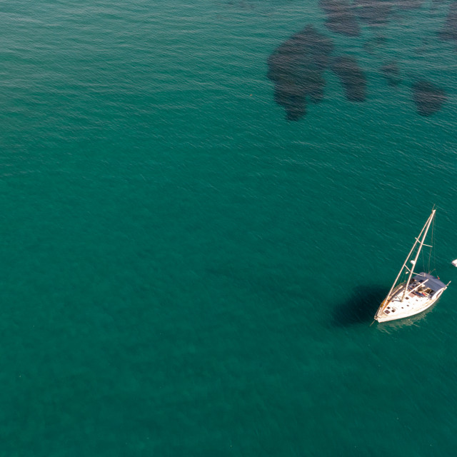 """""""Aerial view of a luxury yacht anchored in the surface of the sea. Cyprus vacations"""" stock image"""
