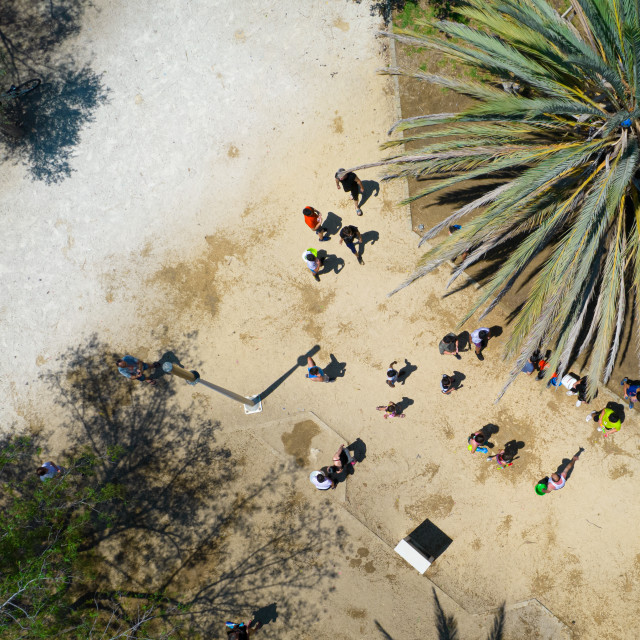 """""""Unrecognised children playing with water in the park. Aerial view of people having fun"""" stock image"""