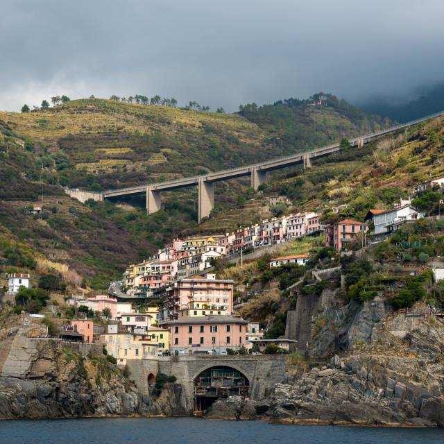 """""""City of Riomaggiore at the edge of a rocky cliff, Cinque Terre Liguria, Italy"""" stock image"""