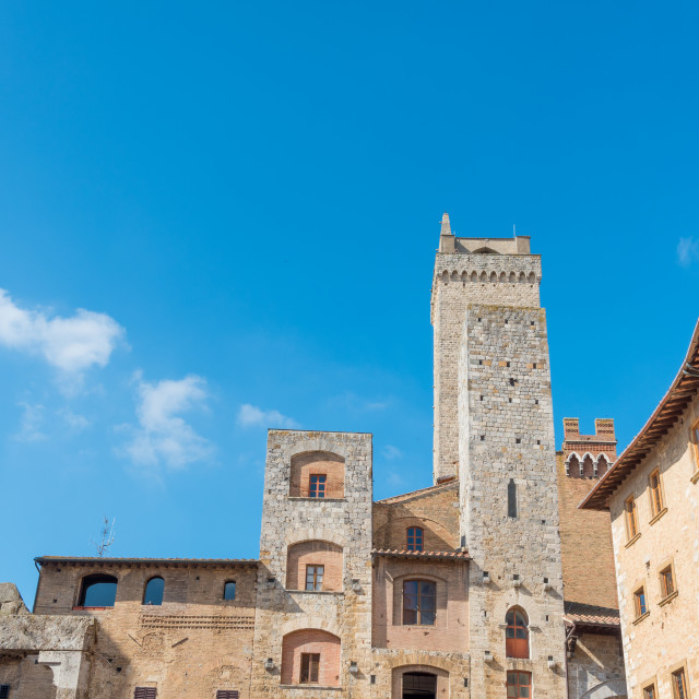 """""""Historical architecture buildings, San Gimignano city Tuscany, Italy against blue sky"""" stock image"""
