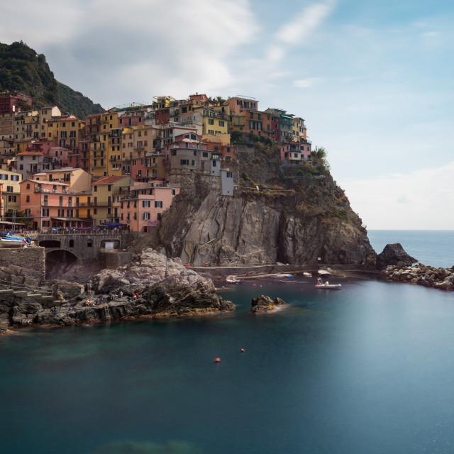 """Village of Manarola with colourful houses at the edge of the cliff Riomaggiore, Cinque Terre, Liguria, Italy"" stock image"