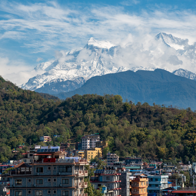 """""""Pokhara cityscape with the Annapurna mountain range covered in snow at central Nepal, Asia"""" stock image"""