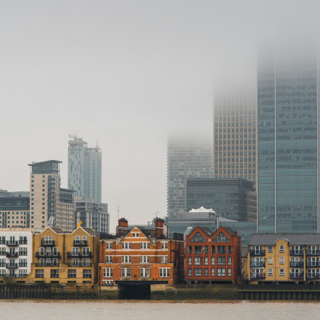 """""""Skyline of Canary Wharf business centre at mist. London united kingdom"""" stock image"""