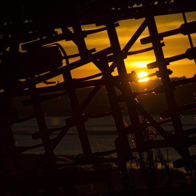 """Sunrise Through a Harvester, Ardullie, Scottish Highlands"" stock image"