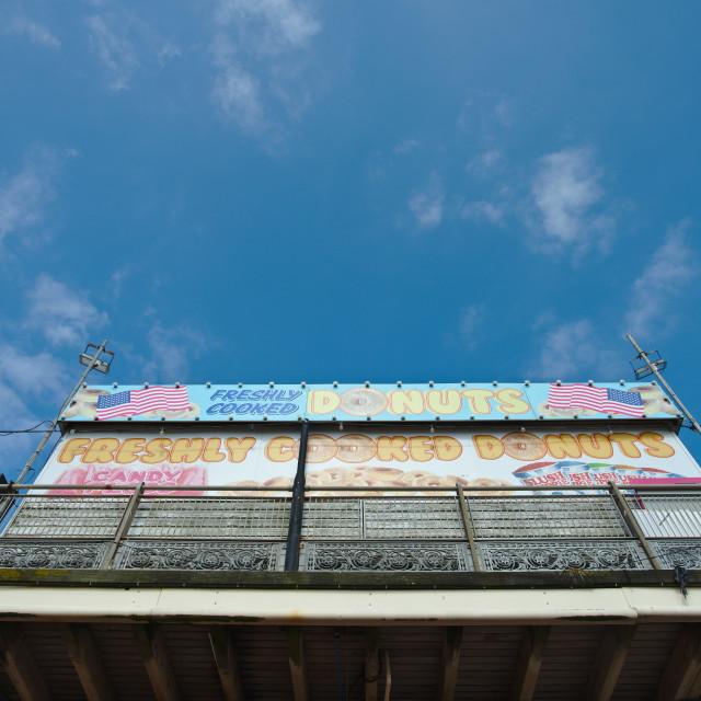 """Donuts vendor, Paignton Pier, Paignton, Devon UK"" stock image"