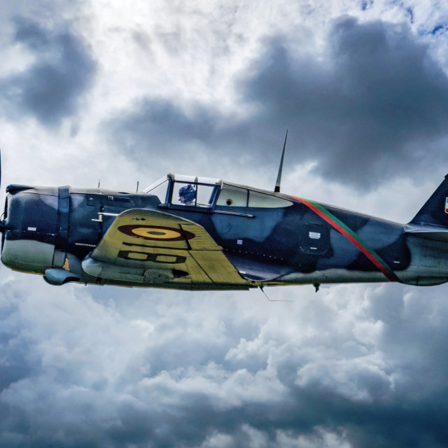 """""""Curtiss Hawk H 75A1 FAF GC2 5 X881 flying over Duxford, UK."""" stock image"""