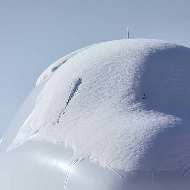 """""""Snow covered cockpit of commercial airplane"""" stock image"""