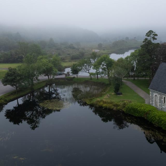 """Aerial drone photo of St Finbarr Church, Gougane Barra, West ireland"" stock image"