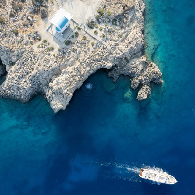 """Drone aerial photograph of Cape Greko peninsula with Agioi Anargyroi church on the rocks. Cruise touristic boats sailing."" stock image"
