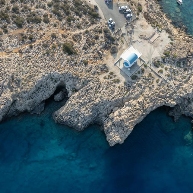 """""""Drone aerial Cape Greko peninsula. Agioi Anargyroi church on the rocks. Cruise touristic boats sailing Cyprus."""" stock image"""