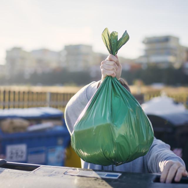 """""""Man carrying garbage bag"""" stock image"""