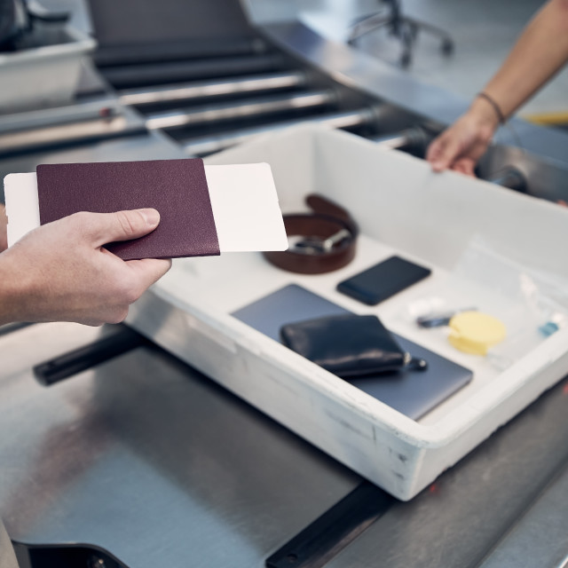 """""""Passenger holding passport at airport security check"""" stock image"""