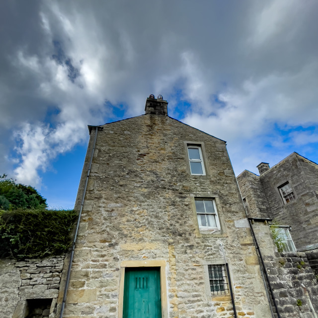 """Hebden, stone built cottage."" stock image"