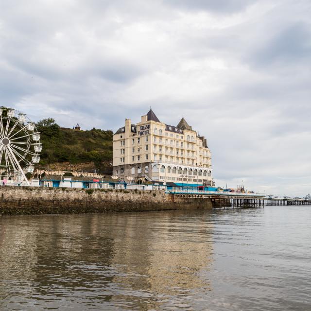 """Llandudno Pier reflecting in the water"" stock image"