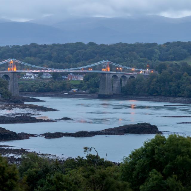"""Menai Suspension Bridge at nightfall"" stock image"