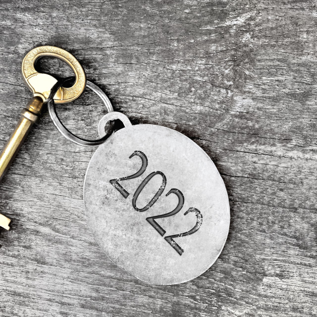 """""""2022 engraved on a ring of an old key on wooden background"""" stock image"""