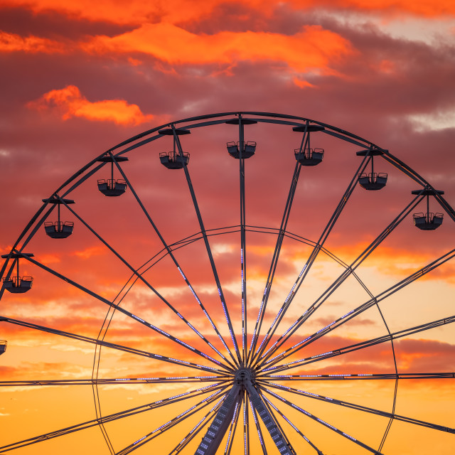 """Ferris Wheel at sunset sky"" stock image"