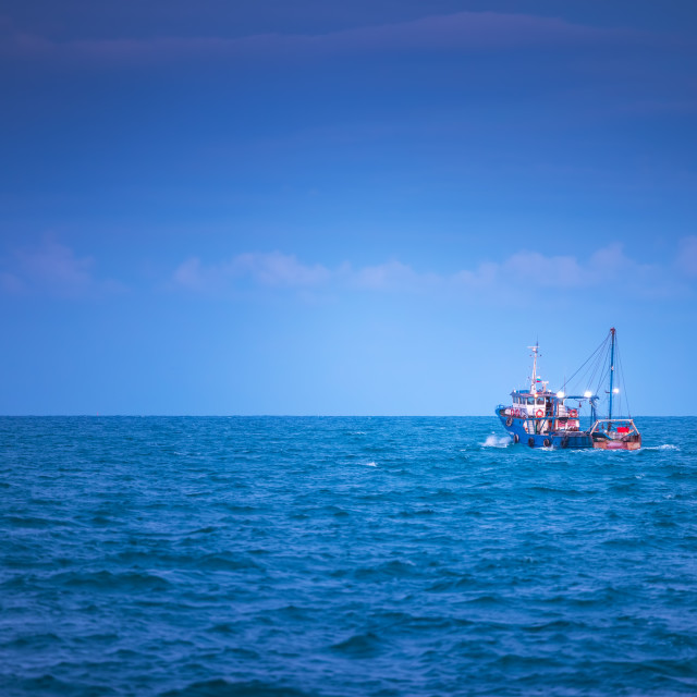 """""""Blue sea waves and sailing cargo ship, scenic view"""" stock image"""