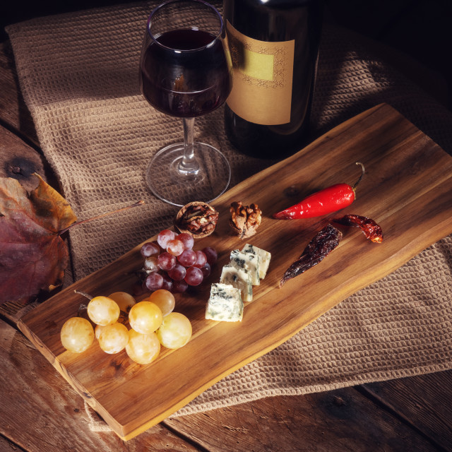 """""""Red wine bottle, grape, cheese, wineglass and chili pepper on wo"""" stock image"""