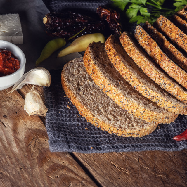 """""""Top view of bread with cheese and chili pepper on the wooden tab"""" stock image"""